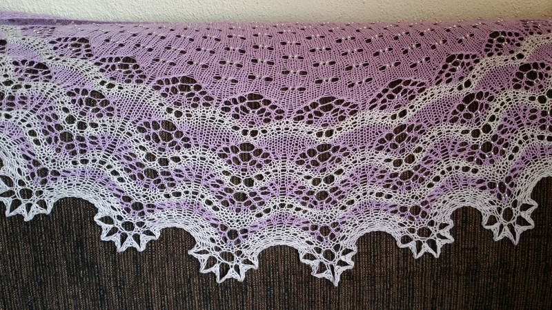 With a dark background, so that you can see the lace better
