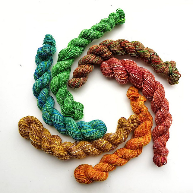 Rainbow skeins. Six mini skeins of yarn, arranged in a circle.