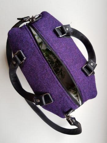 The purse as seen from above. The zipper is open so you can peek inside a little bit.