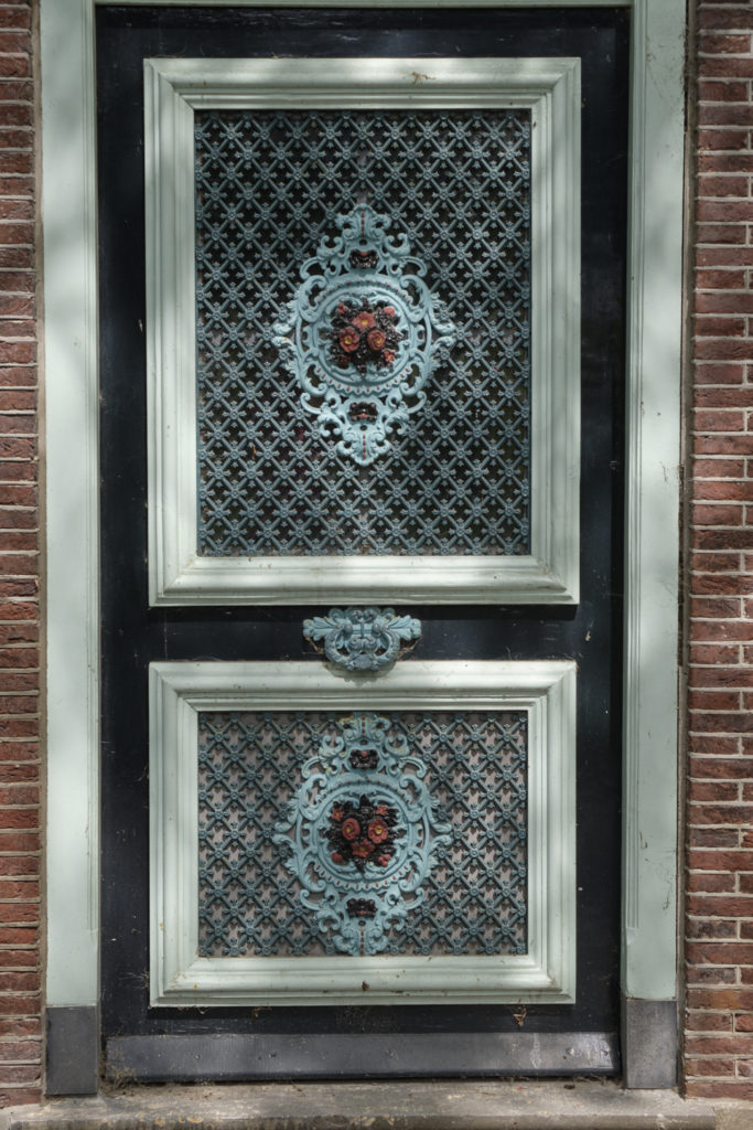 An ornamented front door with iron work