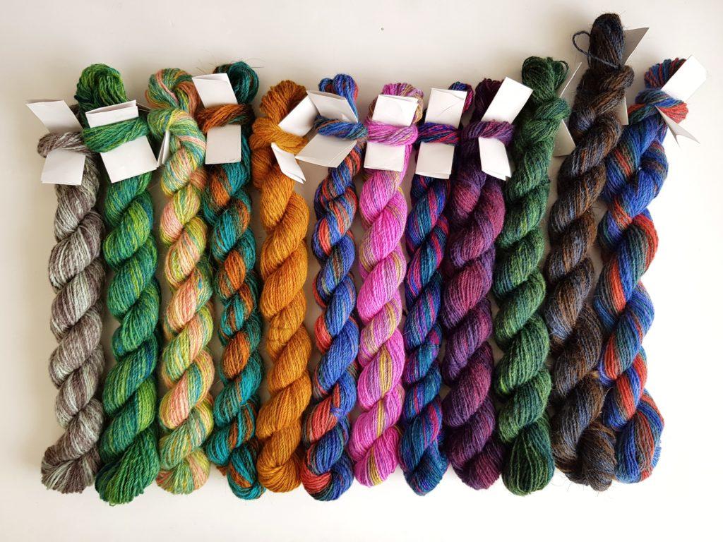 12 mini skeins of colourful yarn.