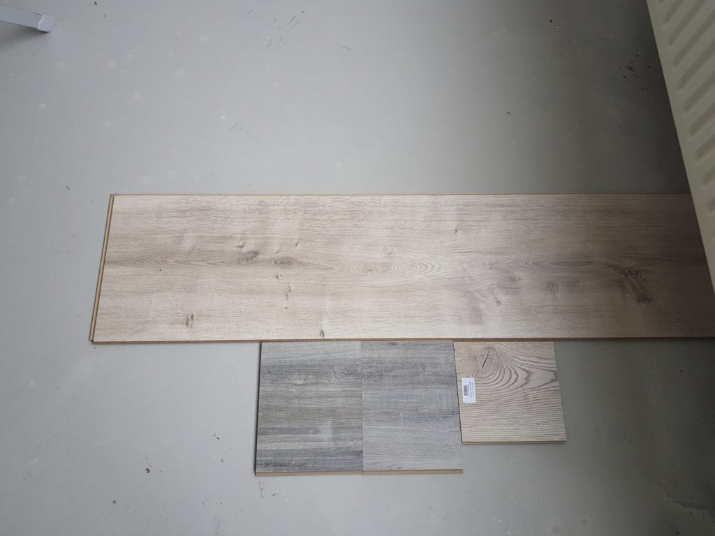 Some laminate flooring samples with different widths. We chose the widest one.