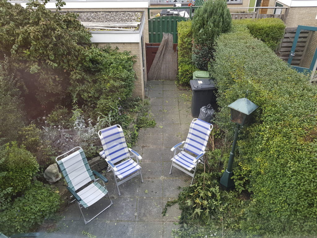 Our backyard, with some garden chairs