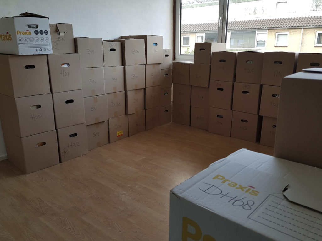 The study is filled with boxes.